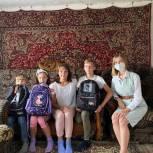 В Кузбассе многодетные семьи получили школьные принадлежности