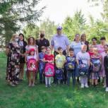Школьникам первого округа вручены 50 портфелей